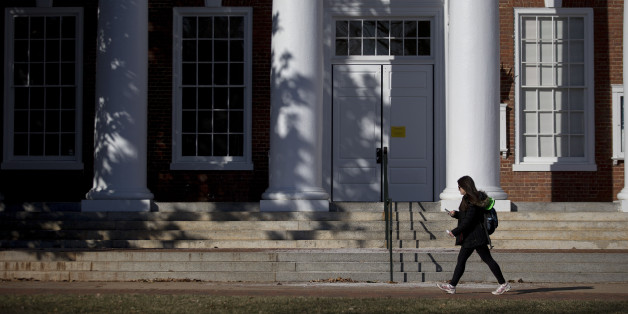 A student walks past Peabody Hall on the University of Virginia campus in Charlottesville, Virginia. (Photographer: Andrew Harrer/Bloomberg via Getty Images)