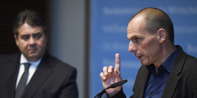 Greece's new Finance Minister Yanis Varoufakis (R) and German Economy Minister Sigmar Gabriel attend a press conference after a meeting in Berlin, on February 5, 2015. The European tour of Greek Finance Minister Yanis Varoufakis which ended in Berlin did nothing to brighten the horizon of Greece at bay, his meeting with his counterpart Wolfgang Schaeuble has especially highlighted 'disagreements' and 'skepticism'. AFP PHOTO / ODD ANDERSEN        (Photo credit should read ODD ANDERSEN/AFP/Getty Images)