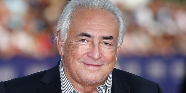 FILE - This Saturday, Sept. 13, 2014, file photo shows former IMF Secretary General Dominique Strauss-Kahn arriving for the award ceremony at the 40th American Film Festival in Deauville, Normandy, western France. The French economist known universally by his initials DSK, faces up to 10 years in prison and a 1.5 million euro ($1.7 million) fine on charges of aggrevated pimping, along with over a dozen other French and Belgian businessmen and police officers at the trial beginning Monday at a co