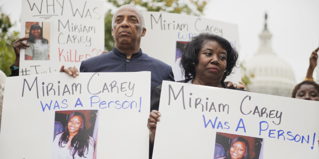 Idella Carey, mother of Miriam Carey who was killed last year by Capitol Police, and Charles Barron, protest Carey's death on the West Front of the Capitol, October 3, 2014. Carey was shot and killed by Capitol Police on October 3, 2013, after a high-speed chase. (Photo By Tom Williams/CQ Roll Call)