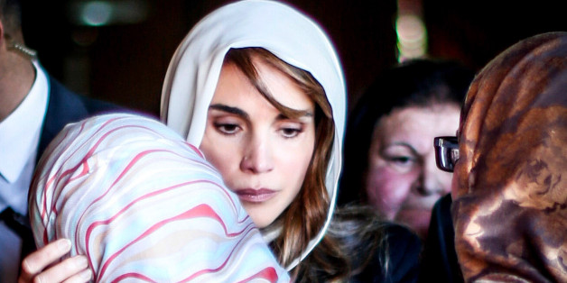 AEY, JORDAN- FEBRUARY 5: Queen Rania of Jordan consoles Anwar Al Tarawneh, the wife of the Jordanian pilot Muath Al Kasasbeh, who was burned to death after being held hostage by Islamic State (IS) on February 5, 2015, in Aey, Jordan. Muath al-Kasaesbeh was captured by the terror group after crashing his plane near Raqqa in northern Syria, during a mission against IS in December.  (Photo by Jordan Pix/ Getty Images)
