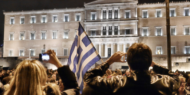 ATHENS, GREECE - FEBRUARY 5:  Thousands of demonstrators gather outside the Greek parliament in support of the new government's tough stance with the EU, on February 5, 2015 in Athens, Greece. Greek Foreign Minister Yanis Varoufakis urged Germany to help end his country's indignity. German Foreign Minister Wolfgang Schaeuble suggested that a reduction in Greece's 322 billion Euro debt was not on the agenda.  (Photo by Milos Bicanski/Getty Images)