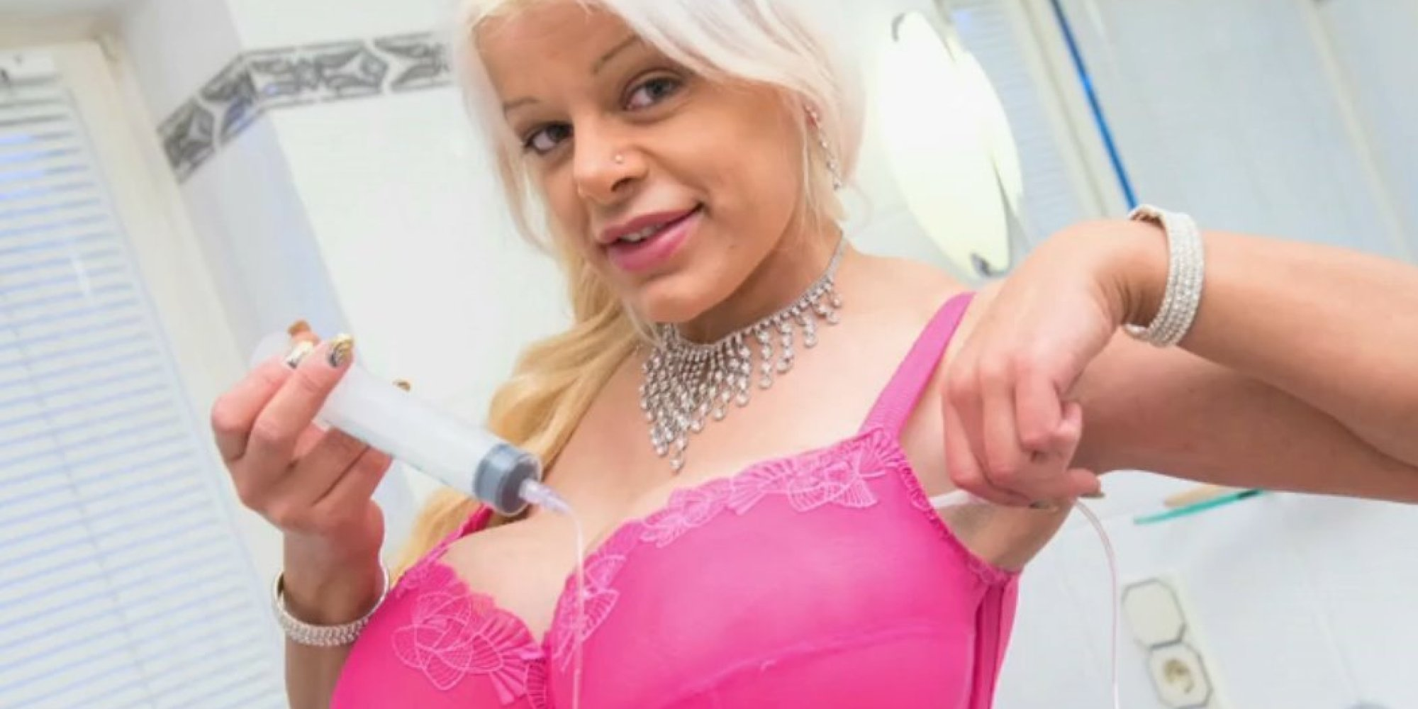 martina big's implants let her pump up her size 32 l breasts | huffpost