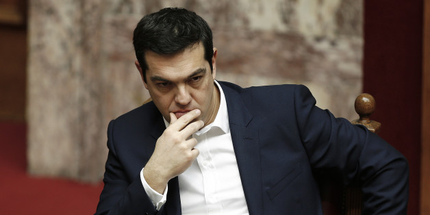 Alexis Tsipras, Greece's prime minister, sits and waits ahead of the swearing-in ceremony for the new government held at the Greek Parliament building in Athens, Greece, on Thursday, Feb. 5, 2015. Greece held fast to demands to roll back austerity as the European Central Bank turned up the heat before Finance Minister Yanis Varoufakis was to meet one of his main antagonists, German counterpart Wolfgang Schaeuble. Photographer: Yannis Behrakis/Pool via Bloomberg