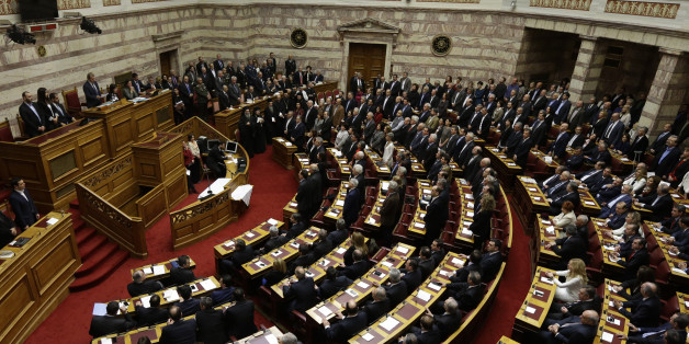 Lawmakers elected in Greece's Jan. 25 national elections are sworn in taking a secular oath at the first convention of Parliament since the elections in Athens on Thursday, Feb. 5, 2015. Non Greek Orthodox lawmakers were sworn in with a secular, or Muslim version of the oath. Jittery investors dumped Greek shares Thursday after the European Central Bank tightened the screws on the country's banking system, piling pressure on the new anti-austerity government to seek a compromise with bailout creditors. (AP Photo/Thanassis Stavrakis)