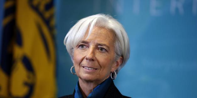 International Monetary Fund (IMF) Managing Director Christine Lagarde, waits to greet British Prime Minister David Cameron, before a round table meeting at the IMF, Thursday, Jan. 15, 2015 in Washington. (AP Photo/Alex Brandon)