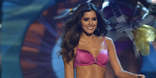 Miss Colombia Paulina Vega walks in her swimsuit during the Miss Universe pageant in Miami, Sunday, Jan. 25, 2015. (AP Photo/Wilfredo Lee)