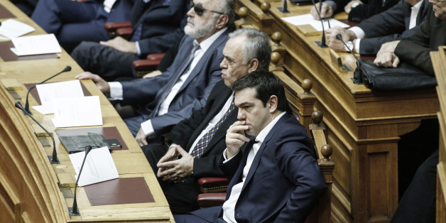 Alexis Tsipras, Greece's prime minister, front center, sits alongside Giannis Dragasakis, Greece's deputy prime minister, ahead of the swearing-in ceremony for the new government held at the Greek Parliament building in Athens, Greece, on Thursday, Feb. 5, 2015. Greece held fast to demands to roll back austerity as the European Central Bank turned up the heat before Finance Minister Yanis Varoufakis was to meet one of his main antagonists, German counterpart Wolfgang Schaeuble. Photographer: Yan