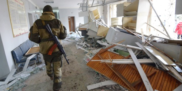 A pro-Russian rebel walks in the hospital of Donetsk's Tekstilshik district after it was hit by a shelling, on Febuary 4, 2015. At least 12 people were killed in fighting between soldiers and pro-Russian separatists in east Ukraine, including four civilians who died when a hospital was hit in rebel stronghold Donetsk today.  AFP PHOTO / DOMINIQUE FAGET        (Photo credit should read DOMINIQUE FAGET/AFP/Getty Images)
