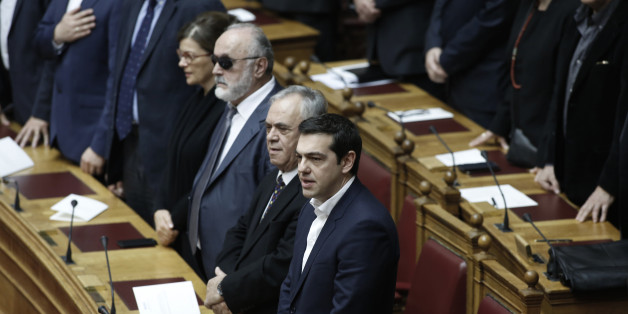 Greece's Prime Minister Alexis Tsipras takes a secular oath at the first convention of Parliament since the Jan. 25 elections in Athens on Thursday, Feb. 5, 2015. Non Greek Orthodox lawmakers were sworn in with a secular, or Muslim version of the oath. Jittery investors dumped Greek shares Thursday after the European Central Bank tightened the screws on the country's banking system, piling pressure on the new anti-austerity government to seek a compromise with bailout creditors. (AP Photo/Yannis