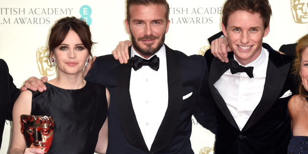 LONDON, ENGLAND - FEBRUARY 08:  Presenter David Beckham (C) poses with Felicity Jones (L) and Eddie Redmayne with the Outstanding British Film award for 'The Theory Of Everything' in the winners room at the EE British Academy Film Awards at The Royal Opera House on February 8, 2015 in London, England.  (Photo by Karwai Tang/WireImage)