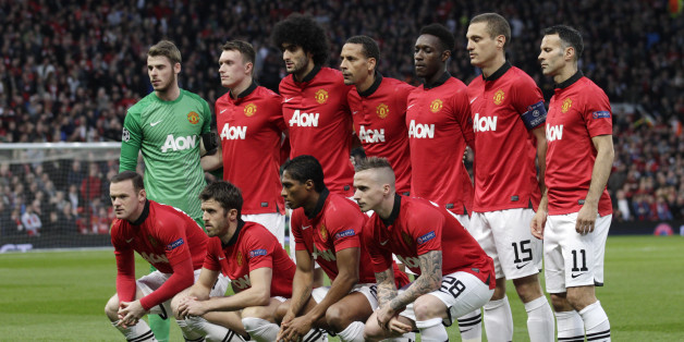 Manchester United players pose for a team photo prior to the Champions League quarterfinal first leg soccer match between Manchester United and Bayern Munich at Old Trafford Stadium, Manchester, England, Tuesday, April 1, 2014.(AP Photo/Jon Super)