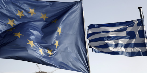 A Greek and a European Union flag billow in the wind as the ruins of the fifth century BC Parthenon temple is seen in the background on the Acropolis hill, in Athens, Friday, Jan. 23, 2015. Prime Minister Antonis Samaras' New Democracy party has failed so far to overcome a gap in opinion polls with the anti-bailout Syriza party ahead of the Jan. 25 general election. (AP Photo/Petros Giannakouris)
