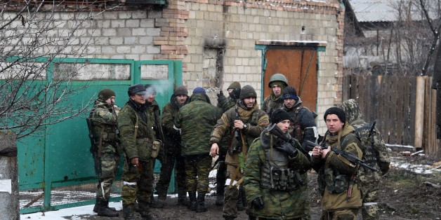 Pro-Russian separatist fighters prepare on February 9, 2015 to go to the frontline near Uglegorsk, 6 kms southwest of Debaltseve. The European Union on February 9 put fresh sanctions against Moscow on hold ahead of a summit to thrash out a Ukraine peace plan aimed at ending 10 months of bloodshed. And US President Barack Obama said on February 9 that the United States had no desire to 'weaken' Russia, but the West had to impose a cost for Moscow's aggression in Ukraine.               AFP PHOTO /