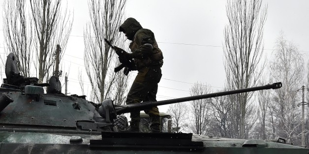 A Pro-Russian separatist stands on the top af a tank on February 9, 2015 in Uglegorsk, 6 kms southwest of Debaltseve. The European Union on February 9 put fresh sanctions against Moscow on hold ahead of a summit to thrash out a Ukraine peace plan aimed at ending 10 months of bloodshed. And US President Barack Obama said on February 9 that the United States had no desire to 'weaken' Russia, but the West had to impose a cost for Moscow's aggression in Ukraine. AFP PHOTO / DOMINIQUE FAGET        (Photo credit should read DOMINIQUE FAGET/AFP/Getty Images)