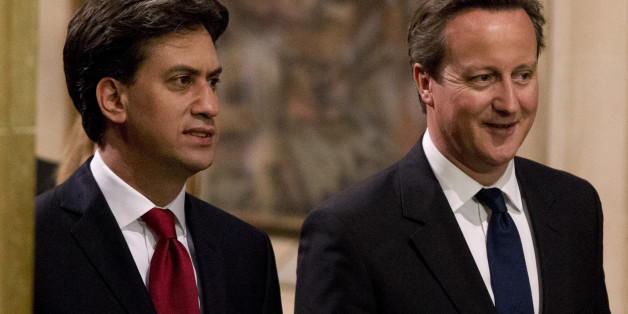 LONDON, ENGLAND - JUNE 04:  (L-R) Leader of the Labour Party Ed Miliband and British Prime Minister David Cameron walk through the Central Lobby after listening to the Queen's Speech at the State Opening of Parliament  on June 4, 2014 in London, England. Queen Elizabeth II will unveil the coalition government's legislative programme in a speech delivered to Members of Parliament and Peers in The House of Lords. Proposed legislation is expected to be introduced on a 5p charge for plastic bags in