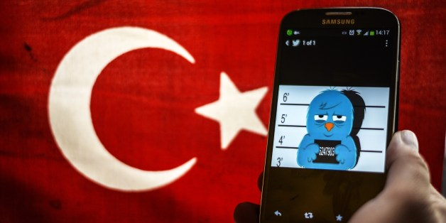 A picture representing a mugshot of the twitter bird is seen on a smart phone with a Turkish flag on March 26, 2014 in Istanbul. A Turkish court on Wednesday overturned the government's controversial Twitter ban imposed after audio recordings spread via the social media site implicated Prime Minister Recep Tayyip Erdogan in a corruption scandal. AFP PHOTO / OZAN KOSE        (Photo credit should read OZAN KOSE/AFP/Getty Images)