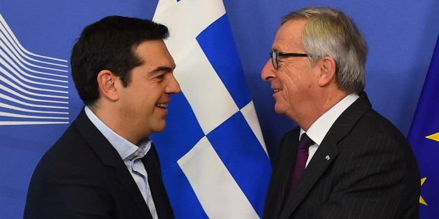 European Commission President Jean-Claude Juncker (R) greets Greek Prime Minister Alexis Tsipras at European Commission headquarters in Brussels on February 4, 2015. The euro held its gains on February 4 after a surge driven by growing optimism that Greece will hammer out a debt deal and avoid a possible default. AFP PHOTO / EMMANUEL DUNAND        (Photo credit should read EMMANUEL DUNAND/AFP/Getty Images)