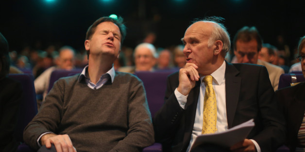 GLASGOW, SCOTLAND - OCTOBER 06:  Deputy Prime Minister Nick Clegg (L) and Business secretary Vince Cable chat in the auditorium during the Liberal Democrat Autumn conference at the SECC on October 6, 2014 in Glasgow, Scotland. During his speech Vince Cable said that the conservatives are 'obsessed' with spending cuts, and that many public services were already 'cut to the bone'.  (Photo by Christopher Furlong/Getty Images)