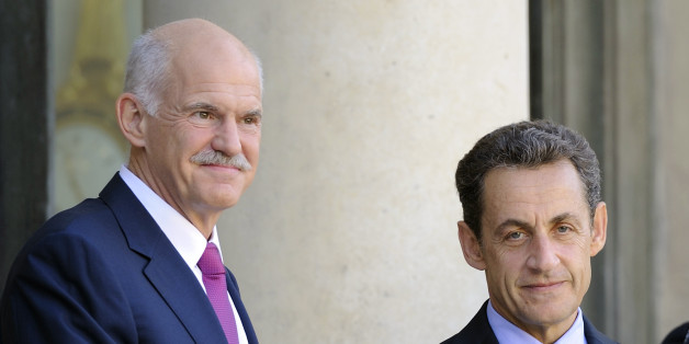 French President Nicolas Sarkozy (R) and Greek Prime Minister George Papandreou pose for photographers prior to a working meeting at the Elysee palace, on September 30, 2011 in Paris. AFP PHOTO ERIC FEFERBERG (Photo credit should read ERIC FEFERBERG/AFP/Getty Images)