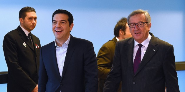 European Commission President Jean-Claude Juncker (R) escorts Greek Prime Minister Alexis Tsipras at European Commission headquarters in Brussels on February 4, 2015. The euro held its gains on February 4 after a surge driven by growing optimism that Greece will hammer out a debt deal and avoid a possible default. AFP PHOTO / EMMANUEL DUNAND        (Photo credit should read EMMANUEL DUNAND/AFP/Getty Images)