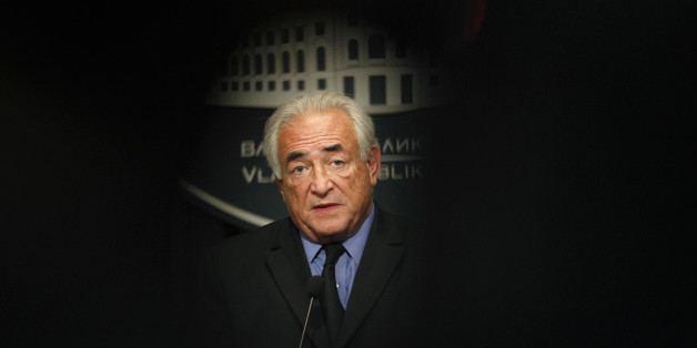 FILE - This Tuesday, Sept. 17, 2013, file photo shows former International Monetary Fund chief Dominique Strauss-Kahn, speaking during a press conference after his meeting with Serbia's deputy Prime Minister Aleksandar Vucic in Belgrade, Serbia. The former head of the International Monetary Fund, whose career nosedived amid accusations he sexually assaulted a hotel maid in New York, is facing Monday Feb.2, 2015 charges in France: aggravated pimping and involvement in a prostitution ring operating out of luxury hotels. (AP Photo/Darko Vojinovic, File)