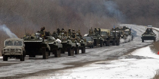 A column of Ukrainian forces roles to Debaltseve as it moves near the eastern Ukrainian town of Artemivsk, in the Donetsk region on February 10, 2015. At least six civilians were killed and 21 wounded in a rocket attack on Ukraine's military headquarters in the war-torn east, local authorities said. The attack also hit residential areas of Kramatorsk, which is considered to be under firm Kiev control. AFP PHOTO / VOLODYMYR SHUVAYEV        (Photo credit should read VOLODYMYR SHUVAYEV/AFP/Getty Im