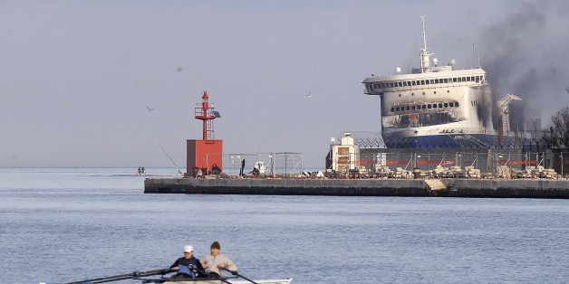 Smoke billows from the Italian-flagged Norman Atlantic ferry after that was towed into the port of Brindisi, southern Italy, Saturday, Jan. 3, 2015. For a second day, fierce heat from a slow-burning blaze kept firefighters and other investigators on Saturday from searching the hold and vehicle decks of a Greek ferry for more bodies. At least 11 people perished in the pre-dawn blaze on Dec. 28 aboard the Norman Atlantic, on a voyage between Greece and Italy. Authorities fear more bodies might be