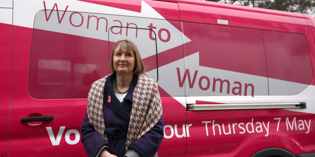 STEVENAGE, ENGLAND - FEBRUARY 11: Deputy Labour leader, Harriet Harman, stands next a pink van launched during a Labour campaign aimed at women voters before a speech on February 11, 2015 in Stevenage, England. Harman has come under fire from a number of commentators who have claimed the pink colour-work is sexist and patronising. (Photo by Carl Court/Getty Images)