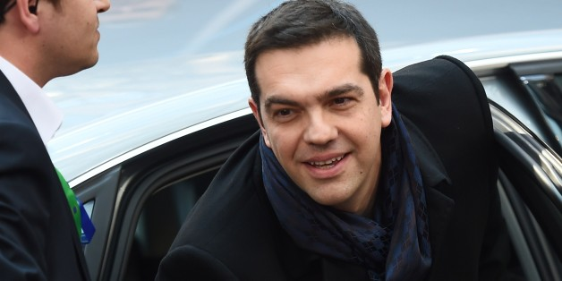 Greek Prime Minister Alexis Tsipras arrives ahead of the European Council Summit at the European Union (EU) Headquarters in Brussels on February 12, 2015.  AFP PHOTO /  EMMANUEL DUNAND        (Photo credit should read EMMANUEL DUNAND/AFP/Getty Images)