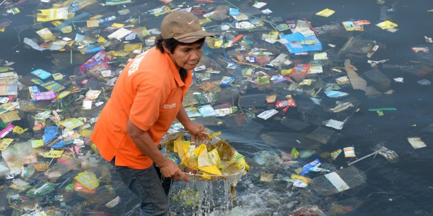 Plastic bags and other rubbish are collected from the waters of Manila Bay on July 3, 2014 during a campaign by environmental activists and volunteers calling for a ban of the use of plastic bags. Volunteers from various environmental advocates collected and separated assorted plastic rubbish polluting Manila Bay and called for national legislation against plastic bags in observance of the 5th International Plastic Bag-Free Day on July 3.     AFP PHOTO / Jay DIRECTO        (Photo credit should read JAY DIRECTO/AFP/Getty Images)