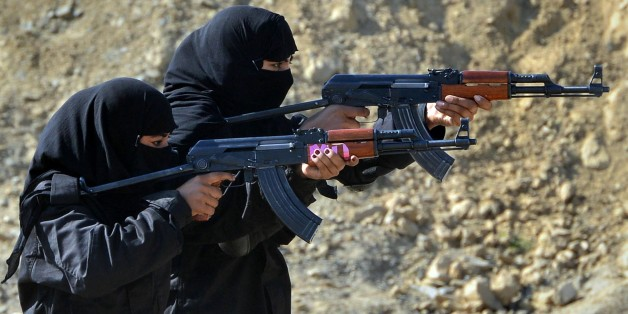 Pakistani policewomen demonstrate their skills during a special elite police training course at a police training centre in Nowshera, a district in the Khyber Pakhtunkhwa Province on February 11, 2015.  Dozens of male and female police took part in a commando training course, introduced by the local police as an additional skill for the police to be deployed to confront terrorism and extremism which is routinely on the rise in this South Asian nuclear-armed country.   AFP PHOTO / A MAJEED        (Photo credit should read A Majeed/AFP/Getty Images)