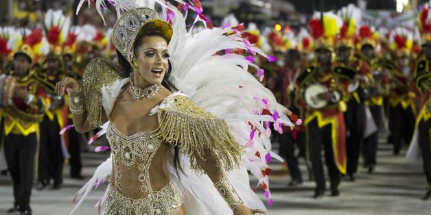 Drum Queen Carla Prata from the Academicos do Grande Rio samba school parade during carnival celebrations at the Sambadrome in Rio de Janeiro, Brazil, Tuesday, Feb. 12, 2013. (AP Photo/Felipe Dana)