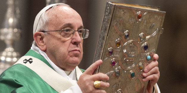 Pope Francis holds the Gospels book as he celebrates a Mass for newly-elected cardinals, in St. Peter's Basilica at the Vatican, Sunday, Feb. 15, 2015. Pope Francis welcomed 20 new cardinals Saturday into the elite club of churchmen who will elect his successor and immediately delivered a tough-love message to them, telling them to put aside their pride, jealousy and self-interests and instead exercise perfect charity. (AP Photo/Andrew Medichini)