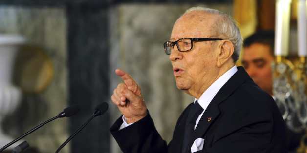 "Tunisian President Beji Caid Essebsi delivers his speech during a cabinet takeover ceremony in Tunis, Friday, Feb. 6, 2015.  Prime Minister Essid, whose cabinet has ministers from four parties including the powerful Islamist group, promised ""work and nothing but work"" on the country's economic and security problems.  (AP Photo/Hassene Dridi)"