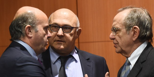 (L-R) Spanish Finance minister Luis de Guindos Jurado, French Finance minister Michel Sapin and Italian Finance minister Pier Carlo Padoan attend an Eurogroup finance ministers meeting at the European Council in Brussels, on February 16, 2015. AFP PHOTO/Emmanuel Dunand        (Photo credit should read EMMANUEL DUNAND/AFP/Getty Images)