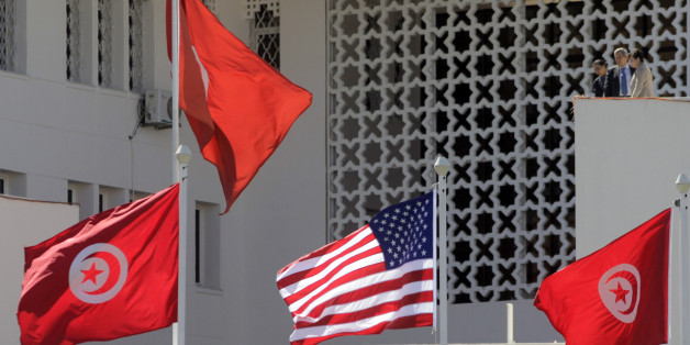 Tunisian and a United States flags flying at the Tunisian Foreign Ministry, for the visit of the US Secretary of State Hillary Clinton, n Tunis, Tunisia, Thursday , March 17, 2011. (AP Photo/Lefteris Pitarakis)