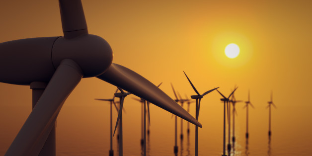 Alternative energy- close up of floating wind farm turbine at sunset.
