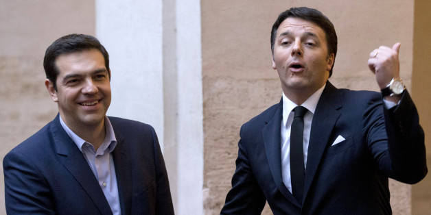 Italian Premier Matteo Renzi, right, and Greek Prime Minister Alexis Tsipras shake hands for photographers before a meeting at Rome's Palazzo Chigi government office, Tuesday, Feb. 3, 2015. Tsipras and  Greek Finance Minister, Yanis Varoufakis, were in Rome Tuesday for talks with government officials. (AP Photo/Andrew Medichini)