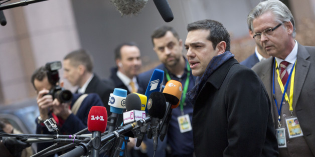 Greek Prime Minister Alexis Tsipras, second right, speaks with the media as he arrives for an EU summit in Brussels on Thursday, Feb. 12, 2015. EU leaders meet for a one-day summit on Thursday to discuss, among other issues, European banks and the situation in Ukraine.(AP Photo/Virginia Mayo)