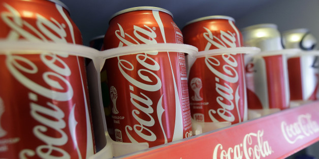 In this June 30, 2014 photo cans of Coca-Cola soda pop are shown in the refrigerator inside of Chile Lindo in San Francisco. San Francisco and Berkeley are aiming to become the first U.S. cities to pass per-ounce taxes on sugary drinks. (AP Photo/Jeff Chiu)