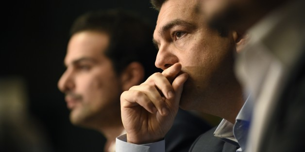 Greek Prime Minister Alexis Tsipras gives a press conference during the European Council Summit at the European Union (EU) Headquarters in Brussels on February 12, 2015. Greece's new Prime Minister Alexis Tsipras and German Chancellor Angela Merkel played down tensions today over demands by Athens to renegotiate its huge bailout as they met for the first time at a European summit.  AFP PHOTO / JOHN THYS        (Photo credit should read JOHN THYS/AFP/Getty Images)