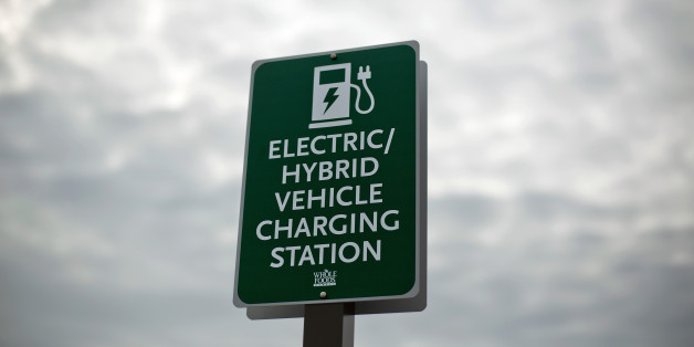 In this Thursday, Feb. 5, 2015 photo, a sign designates a parking space and charging station for electric vehicles outside a supermarket in Alpharetta, Ga. Electric vehicles are particularly popular in metro Atlanta, where electric vehicle owners can use highway lanes off-limits to solo drivers in a traditional car and a Nissan dealership runs regular radio ads claiming best in the nation sales of the plug-in Leaf. (AP Photo/David Goldman)