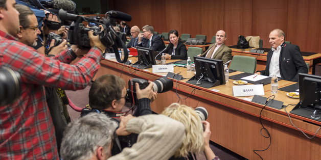 Greek Finance Minister Yanis Varoufakis, right, and Spanish Economy Minister Luis de Guindos, second right, are photographed during a round table meeting of eurogroup finance ministers in Brussels on Friday, Feb. 20, 2015. Eurozone finance ministers meet for a crucial day of talks Friday to see whether a Greek debt relief proposal is acceptable to Germany and other nations using the common currency. (AP Photo/Geert Vanden Wijngaert)