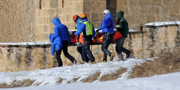 French rescuers carry on January 25, 2015 in church of Ceillac the body of one of six skiers victims of an avalanche a day earlier in the French Alps. Rescue workers found today the bodies of the six skiers who went missing after being carried away by an avalanche during a trek in the Queyras mountain range. AFP PHOTO/ JEAN-PERRE CLATOT        (Photo credit should read JEAN-PIERRE CLATOT/AFP/Getty Images)