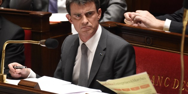 French Prime minister Manuel Valls is pictured during the debate held prior to parliamentary vote of confidence over the government's economic reforms, on February 19, 2015 at the French national Assembly in Paris. The confidence motion was sparked when Prime Minister Manuel Valls on February 17, 2015 employed a rarely-used constitutional device to force through a key package of reforms without a parliamentary vote. AFP PHOTO/ MARTIN BUREAU        (Photo credit should read MARTIN BUREAU/AFP/Gett
