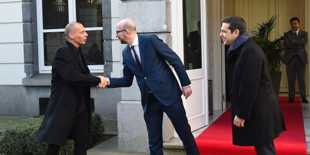 Belgian Prime Minister Charles Michel (C) welcomes Greek Finance Minister Yanis Varoufakis (L) and Greek Prime Minister Alexis Tsipras prior to their meeting within a European summit  in Brussels on February 12, 2015. AFP PHOTO / EMMANUEL DUNAND        (Photo credit should read EMMANUEL DUNAND/AFP/Getty Images)
