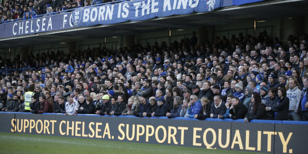 """Chelsea fans watch an English Premier League soccer match against Burnley at the Stamford Bridge ground in London, Saturday, Feb. 21, 2015. British police launched an investigation into further suspected racism involving Chelsea fans as the London club used Saturday's Premier League game to celebrate diversity in football. Stickers emblazoned with """"Support Chelsea Support Equality"""" were handed out at Stamford Bridge after a week when public acts of racism by some Chelsea fans brou"""