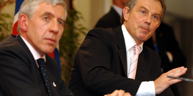 British Prime Minister Tony Blair, right, gestures during a media conference at the end of an EU summit in Brussels Friday June 17, 2005. The failure of the 25 EU leaders to agree on a budget for the European Union in the years ahead has plunged the bloc into a deep crisis. Seated left is British Foreign Secretary Jack Straw. (AP Photo/Geert Vanden Wijngaert)