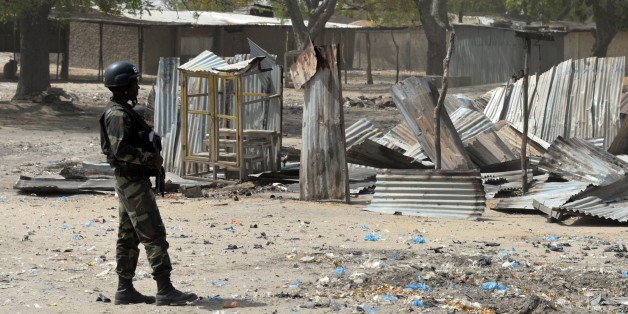 A picture taken on February 17, 2015 shows a Cameroonian soldier walking  in the Cameroonian town of Fotokol, on the border with Nigeria, after clashes occurred on February 4 between Cameroonian troops and Nigeria-based Boko Haram insurgents. Nigerian Boko Haram fighters went on the rampage in the Cameroonian border town of Fotokol on February 4, massacring dozens of civilians and torching a mosque before being repelled by regional forces   AFP PHOTO / REINNIER KAZE        (Photo credit should read Reinnier KAZE/AFP/Getty Images)